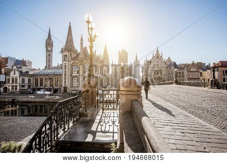 Beautiful view on the old town from saint Nicholas bridge during the sunrise in Gent city, Belgium