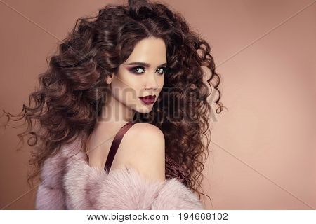 Hairstyle. Fashion Brunette Girl With Long Curly Hair, Beauty Makeup. Glamour Portrait Of Beautiful
