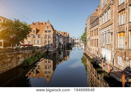 Riverside view with beautiful old buildings and water channel during the morning light in Gent city, Belgium