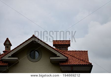 The House Is Equipped With High-quality Roofing Of Ceramic Tiles. A Good Example Of Perfect Roofing.