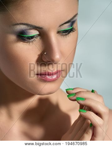 Close up portrait of attractive young girl with professional maquillage
