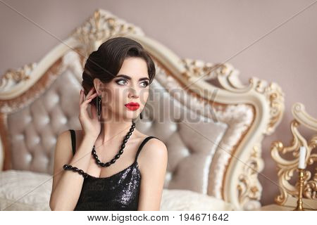 Elegant Brunette Sexy Woman In Fashionable Black Dress. Fashionable Glamour Model With Red Lips Holl