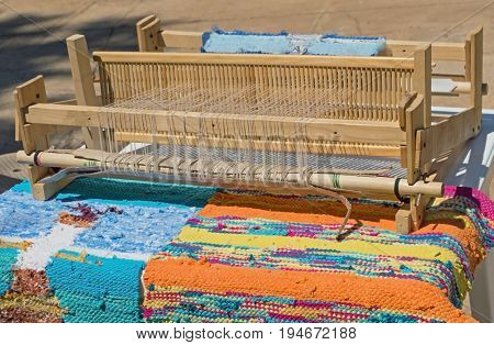 a piece of cloth in a loom
