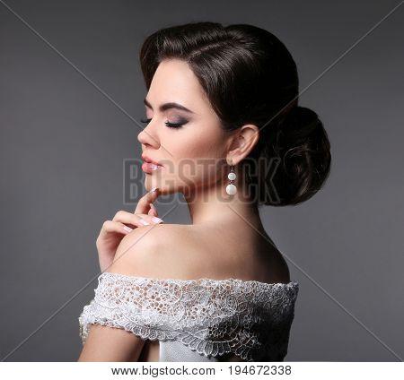 Beauty Fashion Bride Makeup. Elegant Fashionable Woman Portrait. Retro Hair Style. Brunette Model Wi