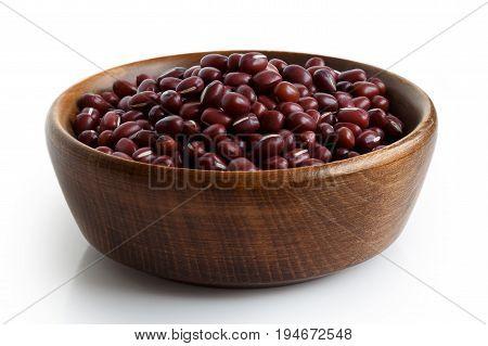 Dry Adzuki Beans In Dark Wooden Bowl Isolated On White.