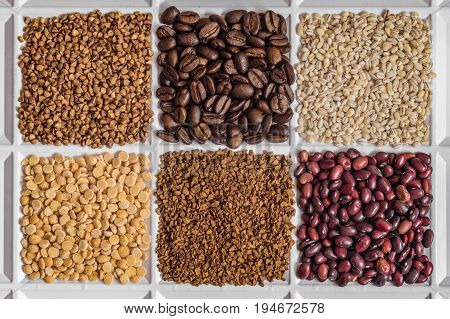 Grocery set of food products: buckwheat roasted coffee beans pearl barley dried peas freeze-dried instant coffee dried seeds of beans.