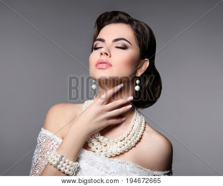 Beauty Bride Makeup. Elegant Fashionable Woman Portrait. Retro Hair Style. Brunette Model With Pearl