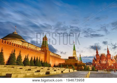 Sunset blue hour view of the Red Square Moscow Kremlin Lenin mausoleum historican Museum in Russia. World famous Moscow landmarks for tourism and travel.