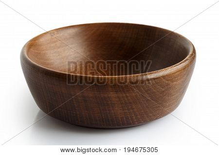 Empty Dark Wooden Bowl Isolated On White.