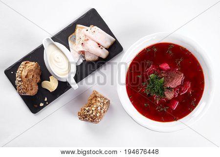 ukrainian soup borsch on white plate. Traditional ukrainian dish borsch isolated on white table, top view. first course