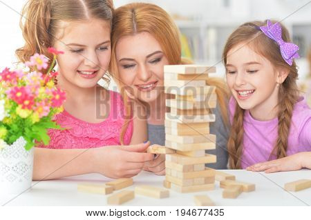 Portrait of happy family playing with blocks together