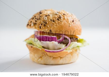 Close up of hamburger with black sesame seed on  table