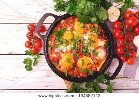 Shakshuka. Traditional Israeli Cuisine. Fried Eggs With Vegetables
