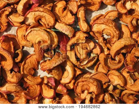 Close-up overview of dried apple slices.The sliced apple are dried in the open air. The concept: vitamins, dried fruits, diet