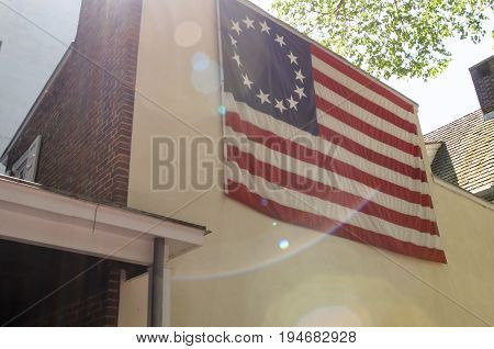 PHILADELPHIA, PA - MAY 14: View of American thirteen point historic flag often named the Betsy Ross flag, in front of the Betsy Ross House at 239 Arch Street on May 14, 2015