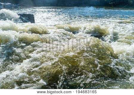 Flowing River Water With Big Rocks