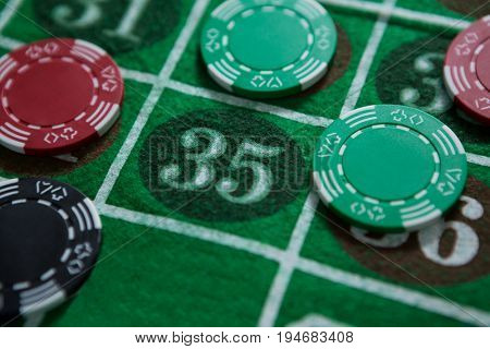 Stack of chips on roulette table at casino