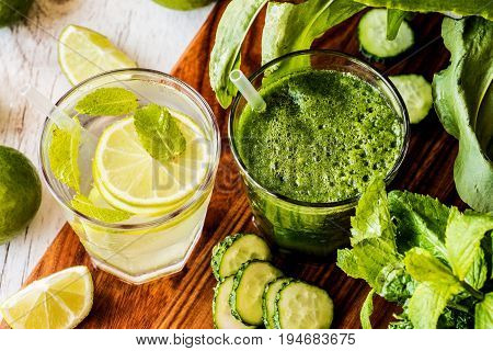 Green Smoothie And Detox Water With Lime, Mint And Ice On Wooden Background. Detox Diet. Close-up