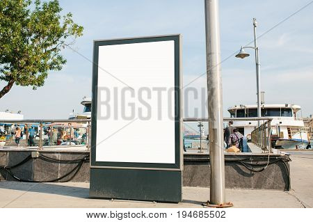 An empty billboard for advertising on the street near the seaport in Istanbul, Turkey. Advertising.