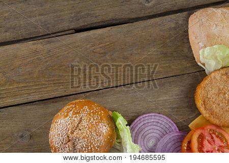 Sliced vegetables ingredient for making hamburger on wooden table