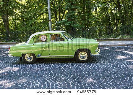 Lviv Ukraine - June 4 2017: Old retro car GAZ - 21 with its owner and au unknown passenger taking participation in race Leopolis grand prix 2017 Ukraine.