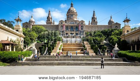 BARCELONA, SPAIN - MAY 2017: People are visiting Fountain and National Museum of Catalonia at Montjuic hill in Barcelona, Placa De Espanya, Spain.