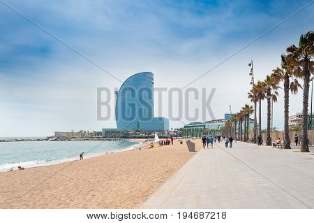 BARCELONA, SPAIN - MAY 2017: Sandy Barceloneta beach with W hotel on a background