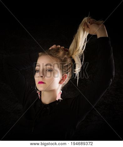 Portrait of a  woman on black background.