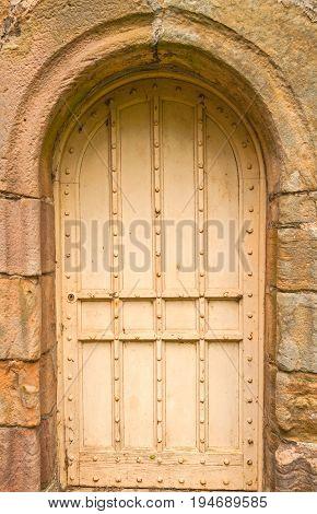 Secret Door, ancient door set in block stone archway