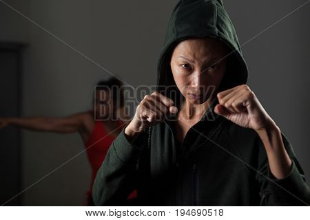 Determined women practicing boxing in fitness studio