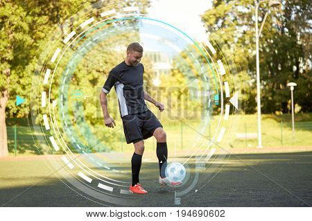 sport, football training and people - soccer player playing and juggling with ball on field