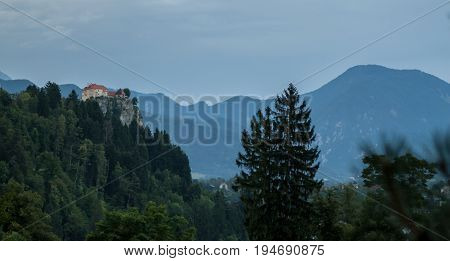 castle on the rock over lake Bled Slovenia dark wether