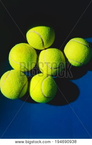A lot of tennis balls on blue background
