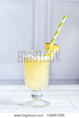 Glass of pina colada on the wooden table
