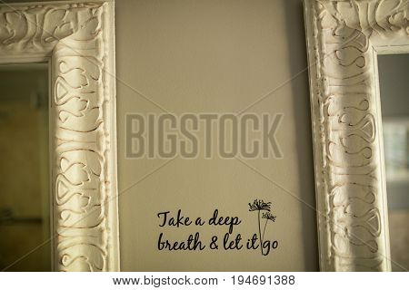 Text on wall by mirrors in bathroom