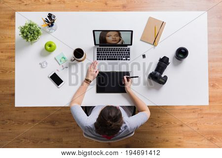 photography, people and design concept - hands with graphic tablet retouching photo on laptop computer and camera at table
