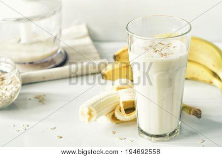 Useful smoothies with a banana and oatmeal. Banana milkshake with oats.