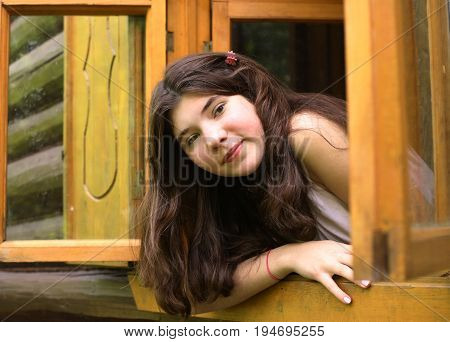 Girl Look Out Of The Wooden Window