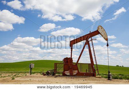 Oil field pump jack on the prairie