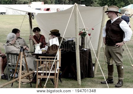 Sandhurst, Uk - 18Th June 2017: Vintage Toned Shot Of Enthusiasts In Ww2 Period Costume At A Militar
