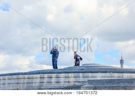 PARIS, FRANCE - JULY 2, 2017: soldiers of French special corps CRS, Compagnies Republicaines de Securite on top of Arc de Triomphe on duty for tourists security.
