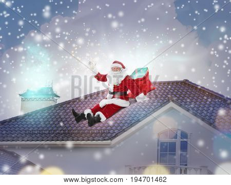 Santa Claus with bag sitting on roof of house. Christmas and New Year 2018 celebration