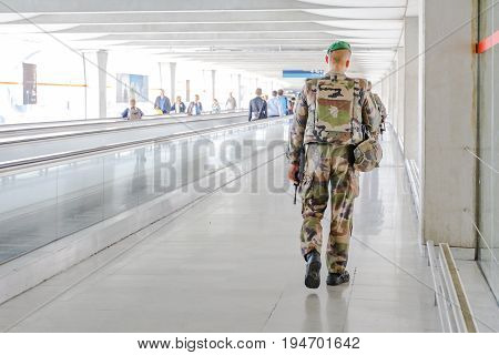 PARIS, FRANCE - JULY 3, 2017: security patrol soldier of National Armed Forces of France at Charles De Gaulle airport, keeping security after recent terrorist attacks in Paris.