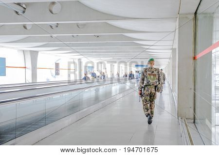 PARIS, FRANCE - JULY 3, 2017: soldiers of French Armed Forces of France patrolling Charles De Gaulle airport, keeping security after recent terrorist attacks in Paris.