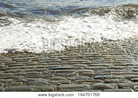 Old Cobbled Slipway Washed by Sea Ocean waves