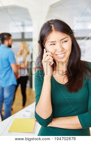 Business woman on the phone at start-up company