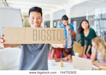 Student holding blank sign in creative ideas workshop