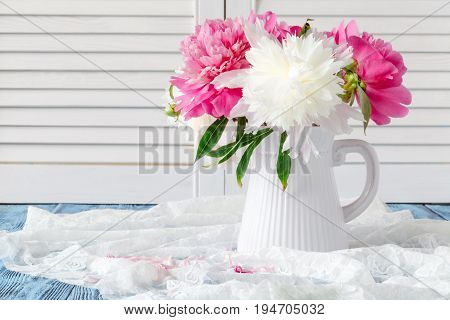 Pink and white peonies still life in vase