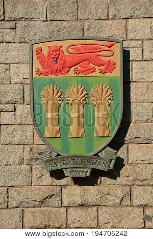 Victoria BC,Canada,August 9th 2014.The coat of arms for the province of Saskatchewan hangs on a wall in Victoria BC.