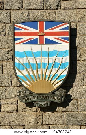 Victoria BC,Canada,August 9th 2014.The coat of arms for the province of British Columbia hangs on a wall in Victoria BC.